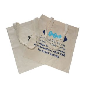 Two, white branded, flat cotton bags.