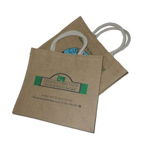 Two, brown branded, flat jute bags with rope handles.