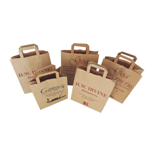 Five brown paper bags with tape handles.