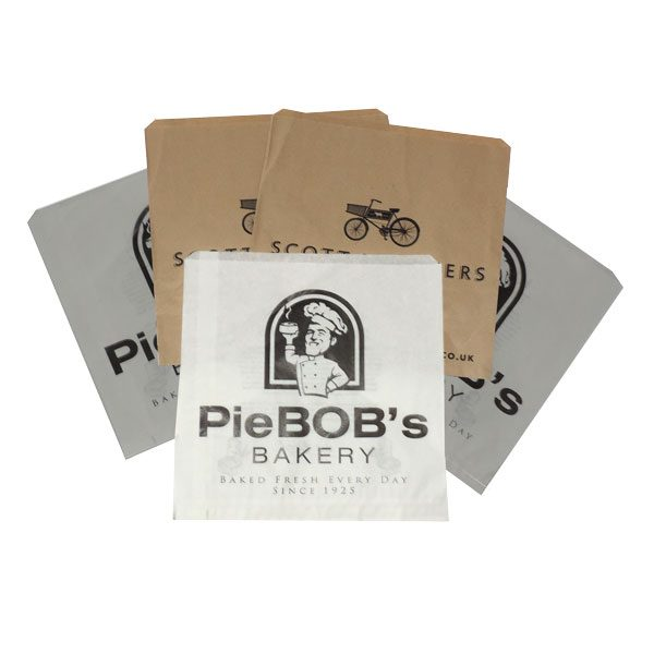 Flat paper food bags, three white, two brown.