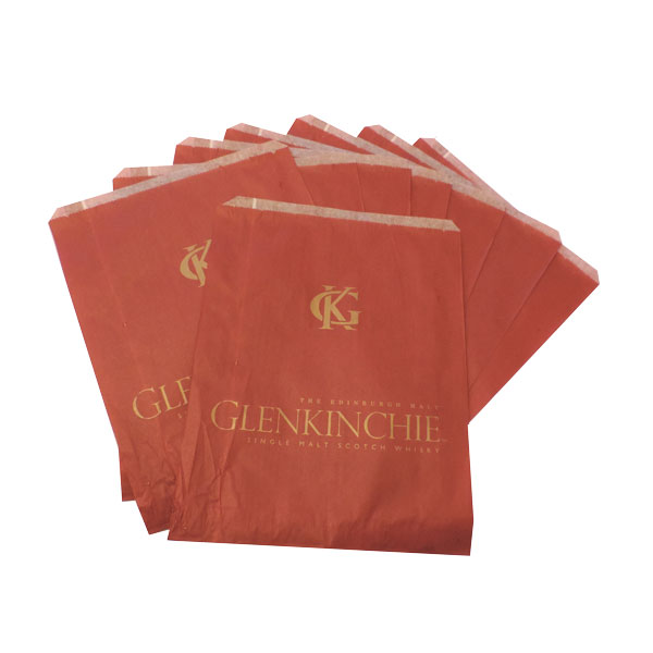 Flat paper food bags, red in colour.