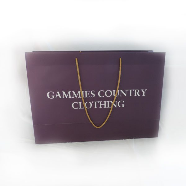 One wine coloured clothing bag with rope handles.