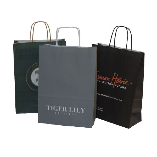 Three branded twisted paper handled bags. One each coloured green, grey, black.