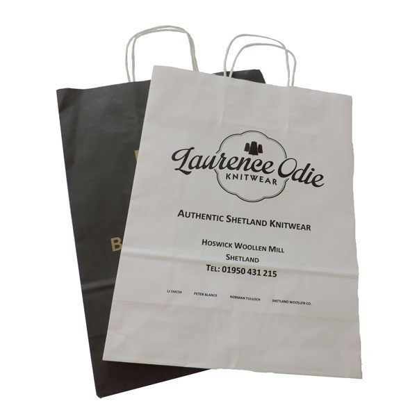 Two flat branded twisted paper handled bags. One black one white.