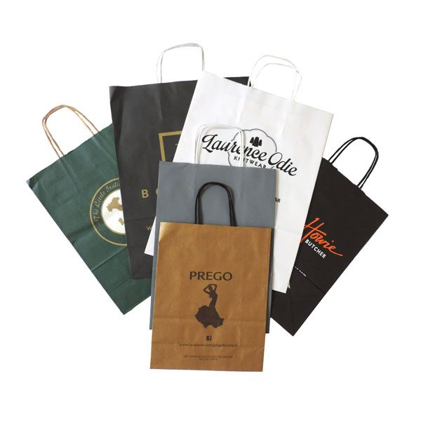 Six flat branded twisted paper handled bags. Various colours and brands.